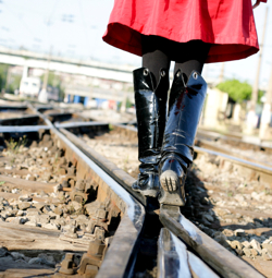 Girl walking on railroad track