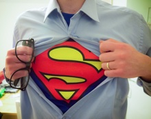Office worker opens shirt to reveal Superman logo