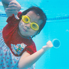 Child swimming in deep end