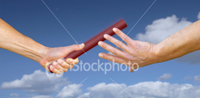 Baton being handed off during relay